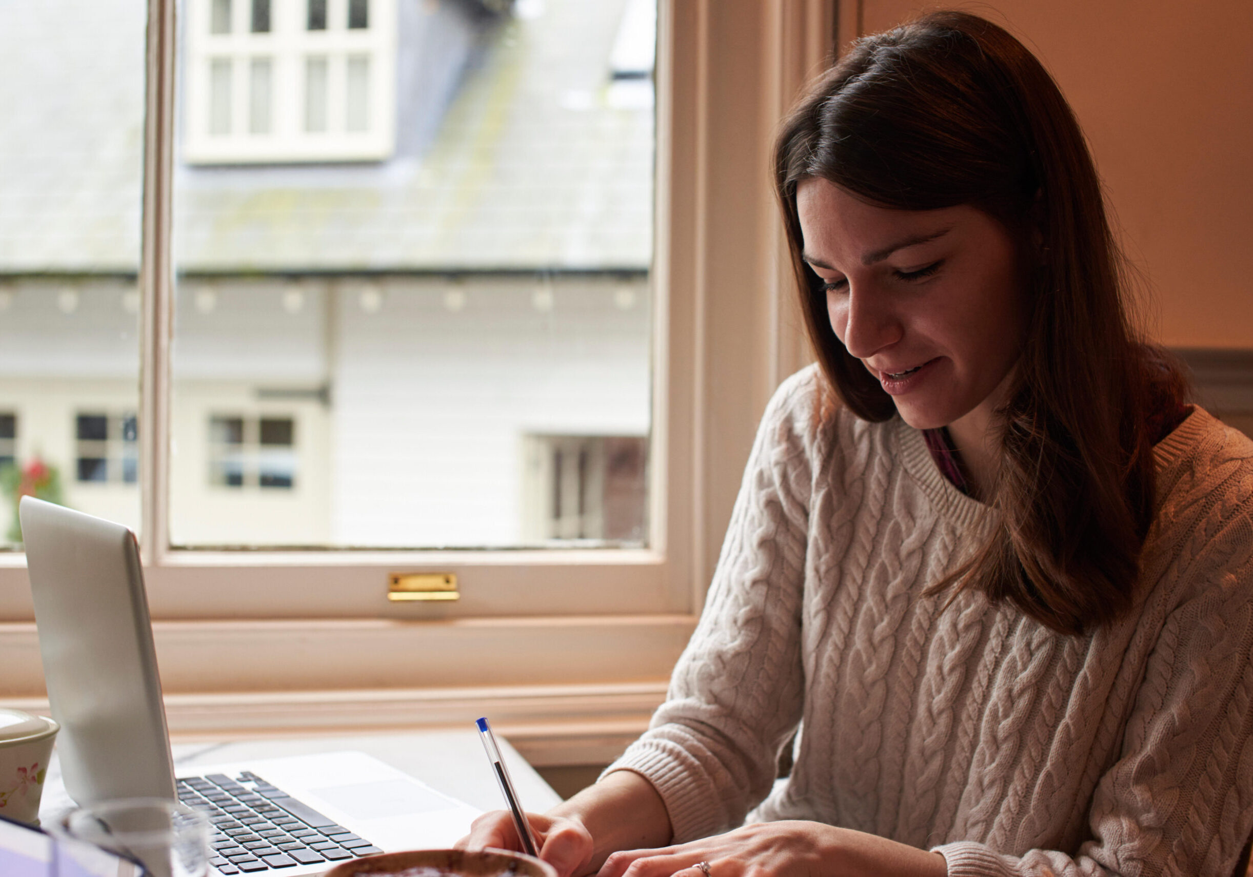 FWWCBW Woman Writing Notes In Business Meeting